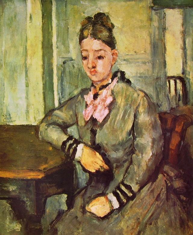 Paul Cezanne: La signora Cezanne appoggiata a un tavolo