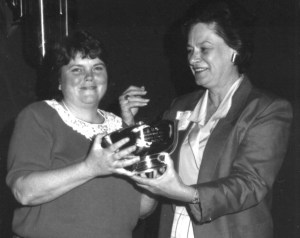 """Barbara Oliver Tootle, """"Barbie"""" to most about everyone, receives the 1987 Panhellenic Woman of the Year Award from Pi Beta Phi Grand President, Jean Wirths Scott. As a collegiate member of the Pi Beta Phi chapter at the Ohio State University, Barbie was a co-winner of Pi Phi's highest individual award. She and future Grand President of Pi Beta Phi, Sarah Ruth """"Sis"""" Mullis, shared the 1965 Amy Burnham Onken Award."""