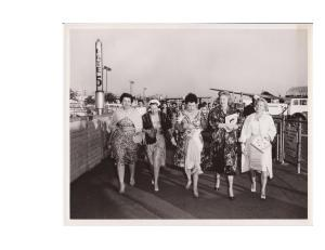 Lucille Ball with honoree Madelyn Pugh Martin (right) as their plane is met by a Kappa contigent.
