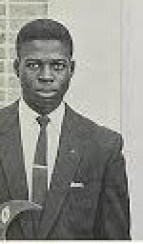 Lou Brock holding a Phi Beta Sigma crescent while a student at Southern University.