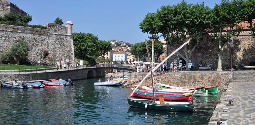 Collioure harbour with colourful lateen boats tied up beside the quay
