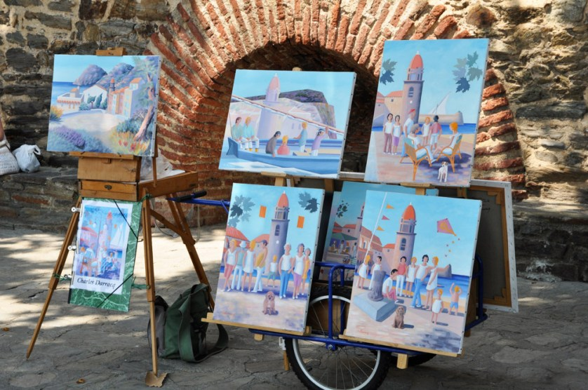 Artists paintings on the harbour wall in Collioure
