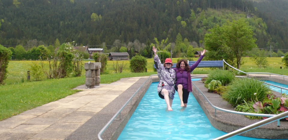 "Ursula and Fran ""stork walking"" in the freezing Kneipp Foot Bath, also known as Kneipp Hydrotherapy."