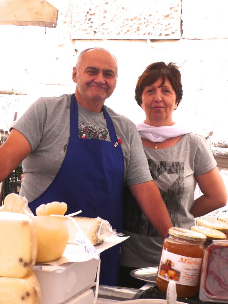 Cheese vendors at the Siracusa market.