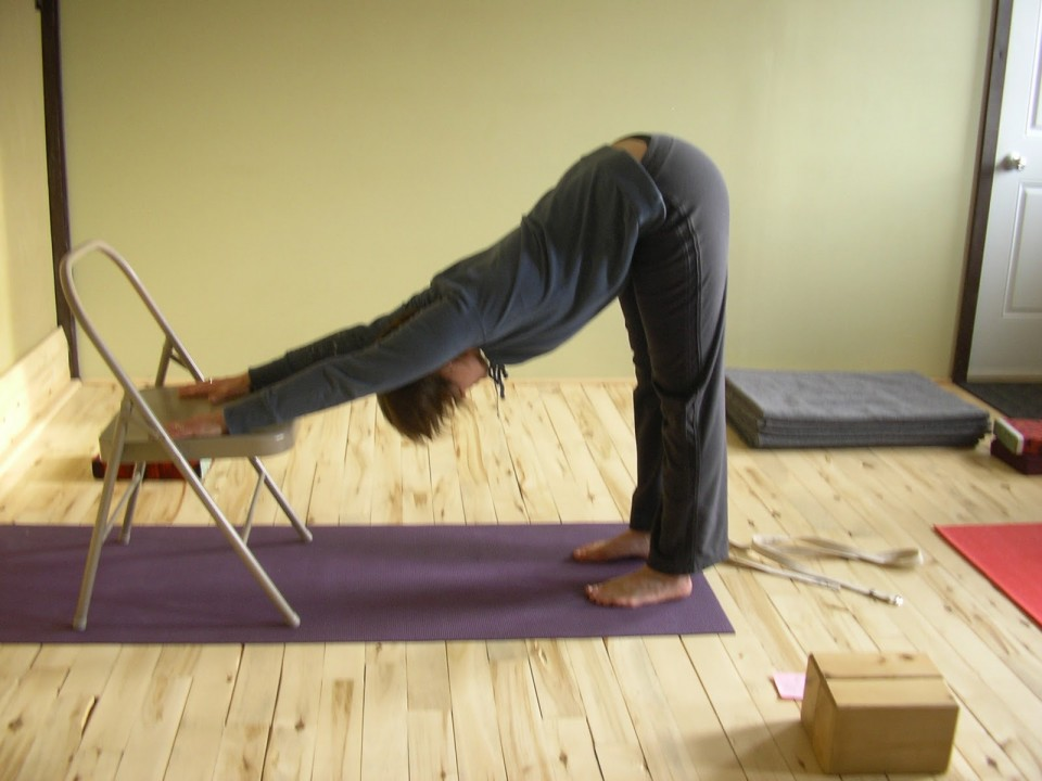 Downward Facing Dog using a chair. Great for shoulders!  Make sure feet are hip distance apart and that your heels are directly under your hip joints for proper alignment.