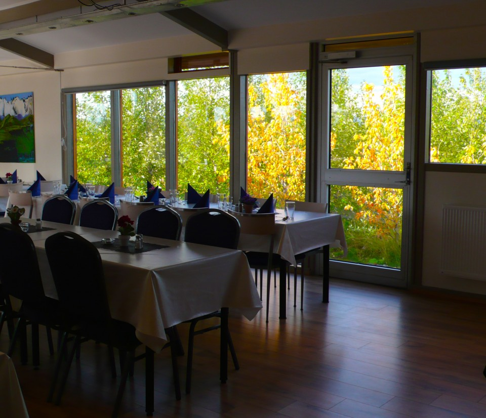 Dining room at Minniborgir Cottages.  You can see the Alaskan aspen are already changing colors.