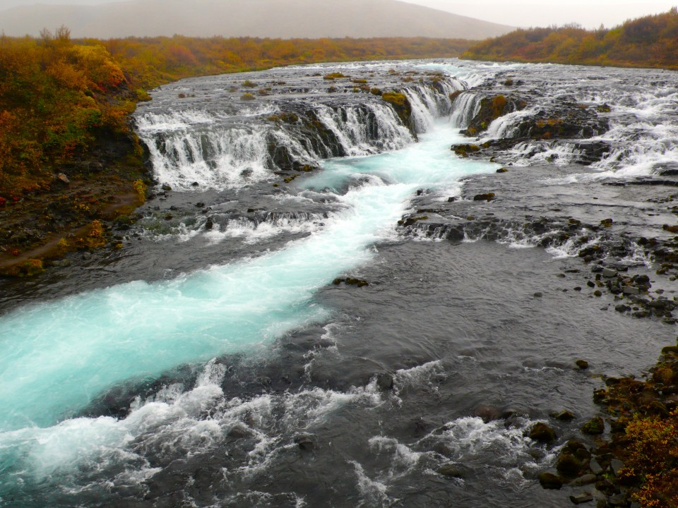 This is Bruarfoss...hard to get to, but worth the fall into a mud hole (me, went hip deep into a hole!) and worth the pelting rain.  Beautiful!