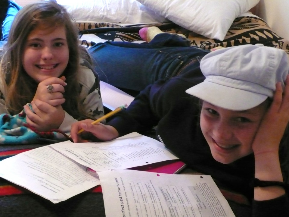 Harmony and Ruah diligently doing their Spanish homework!