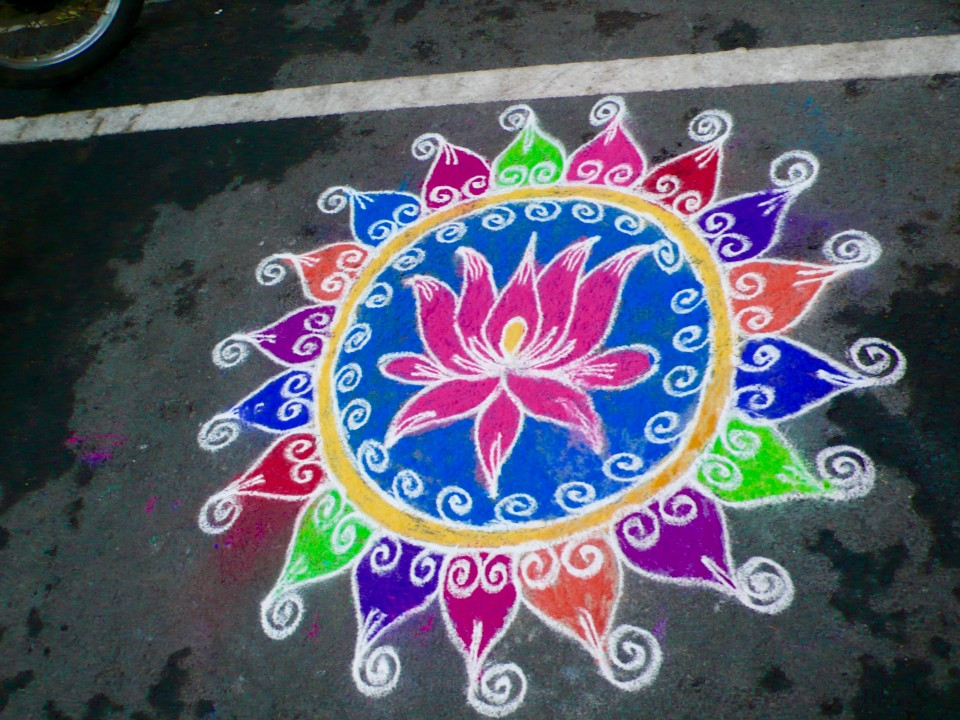 Colorful chalk drawings on sidewalks in front of a home bring auspicious tidings