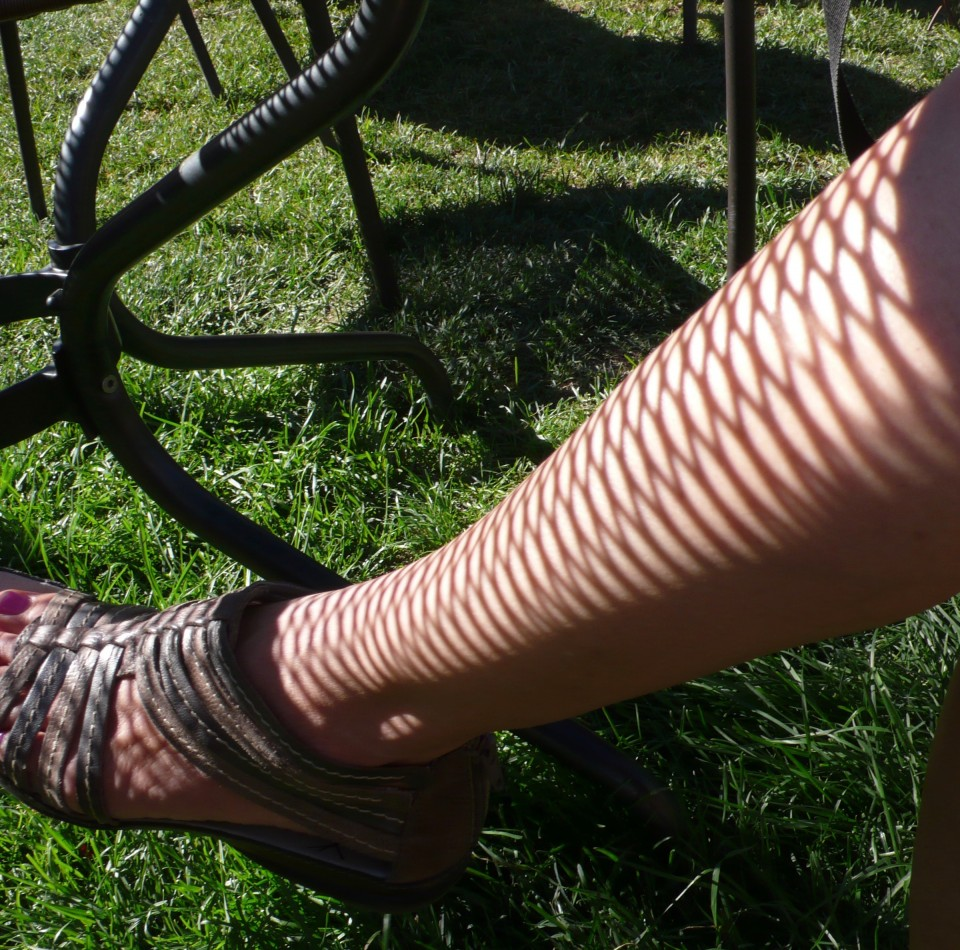 """fishnet"" stockings...shadow on my leg in the beer garden in Cle Elum"