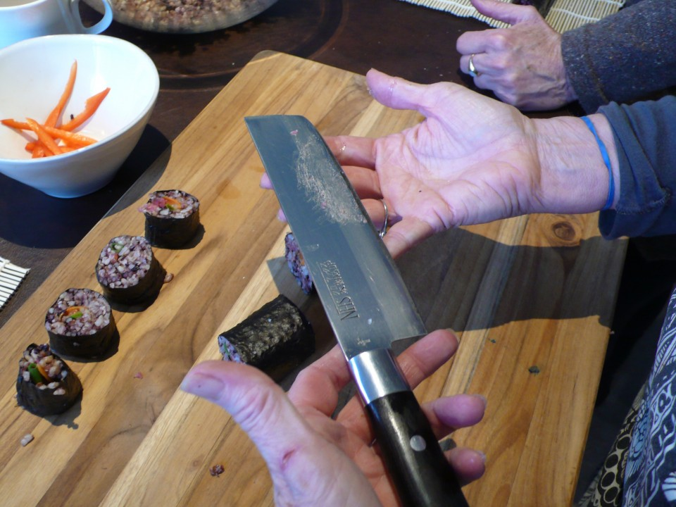 A sharp knife should do the trick of cutting the rolls easily!