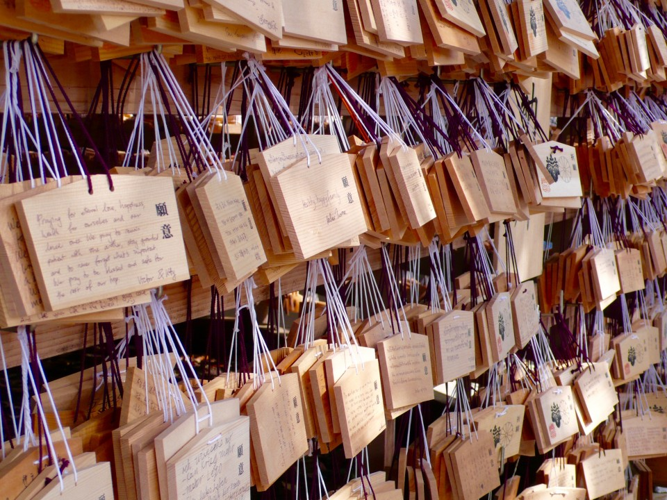 Prayers and Wishes line the walls at the shrine