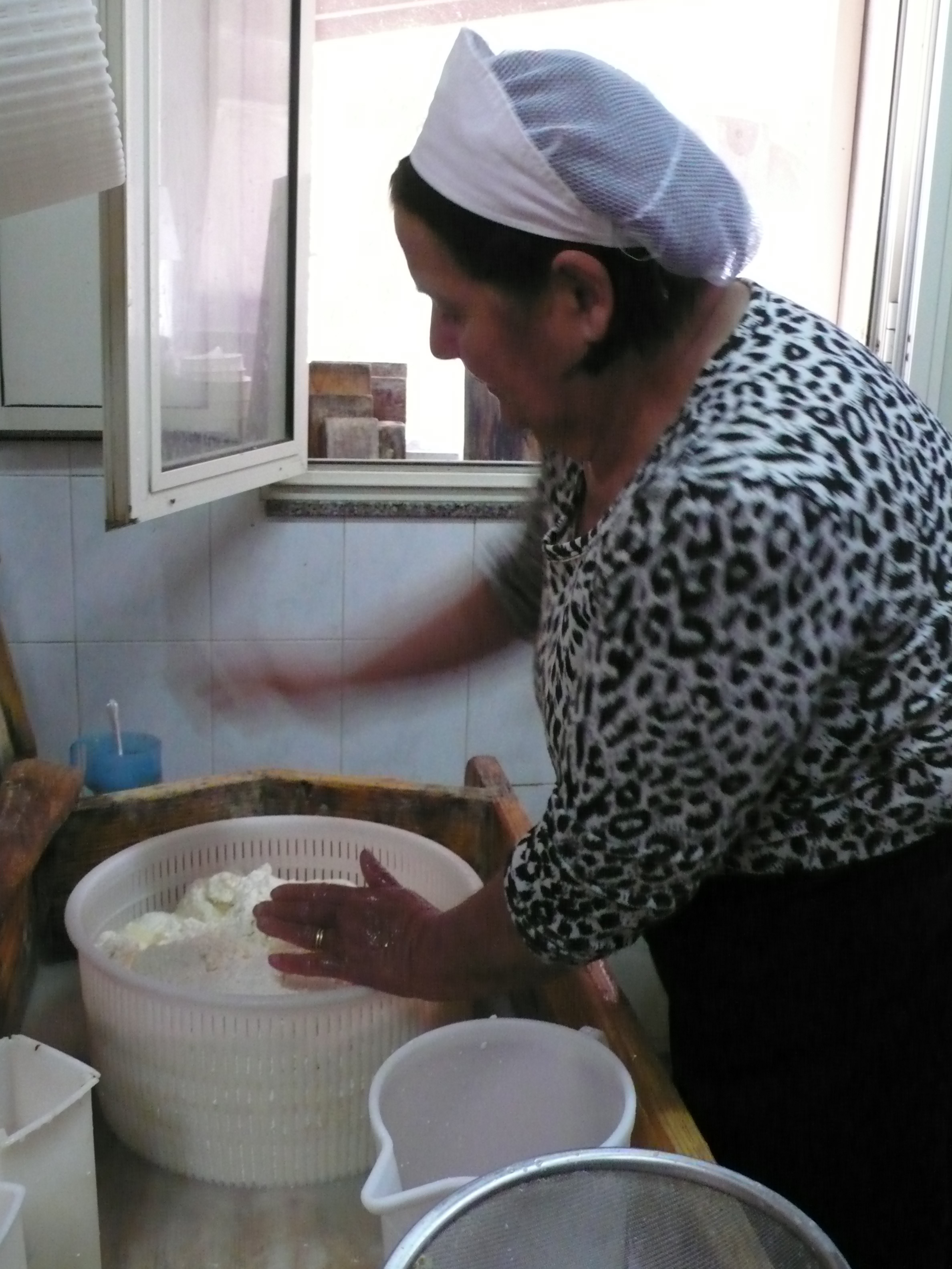 "Maria makes the ""tuma"" for the various cheese."