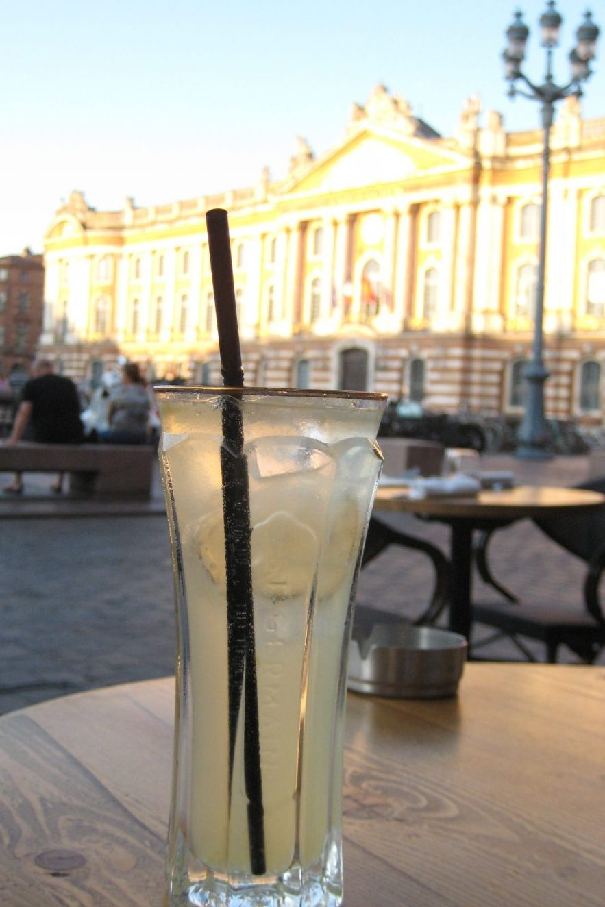Cocktail at Le Bibent at sunset viewing Capitole in Toulouse