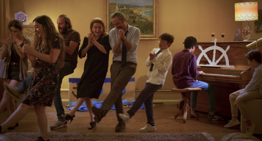 Ensemble cast in birthday scene in Happy Birthday