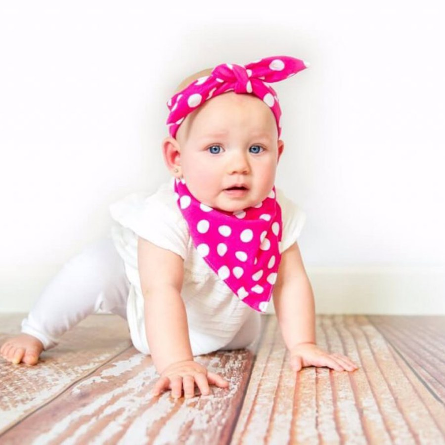 Girl wearing pink and white bib and head wrap