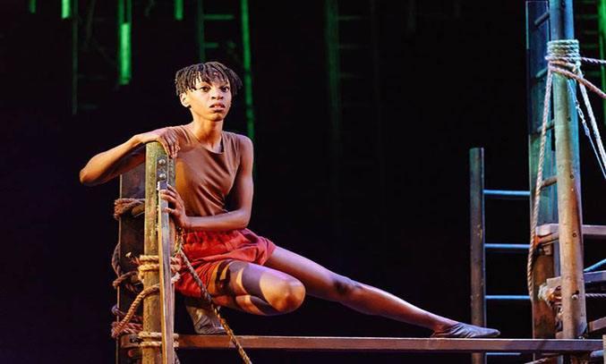 Keziah Joseph as Mowgli in THE JUNGLE BOOK.