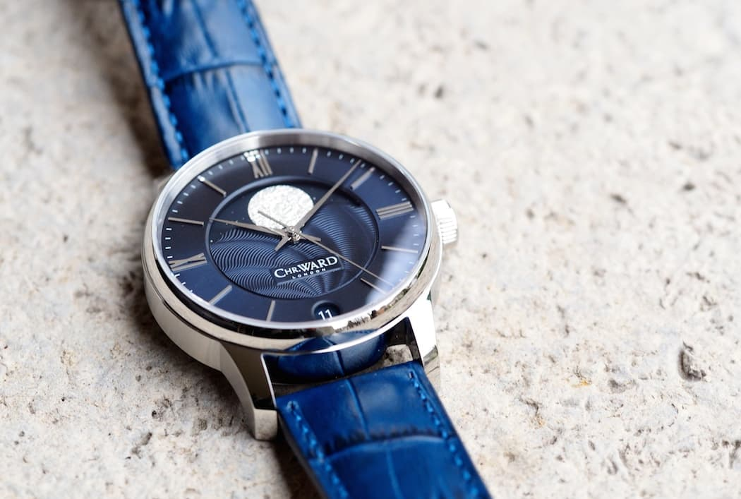 The Christopher Ward C9 Moonphase has applied Roman numeral hour indicators and matching hands