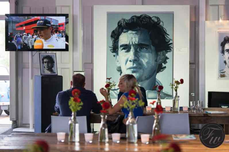 Tudor Historic Grand Prix 2016. On the background race legend Ayrton Senna and Max Verstappen on TV