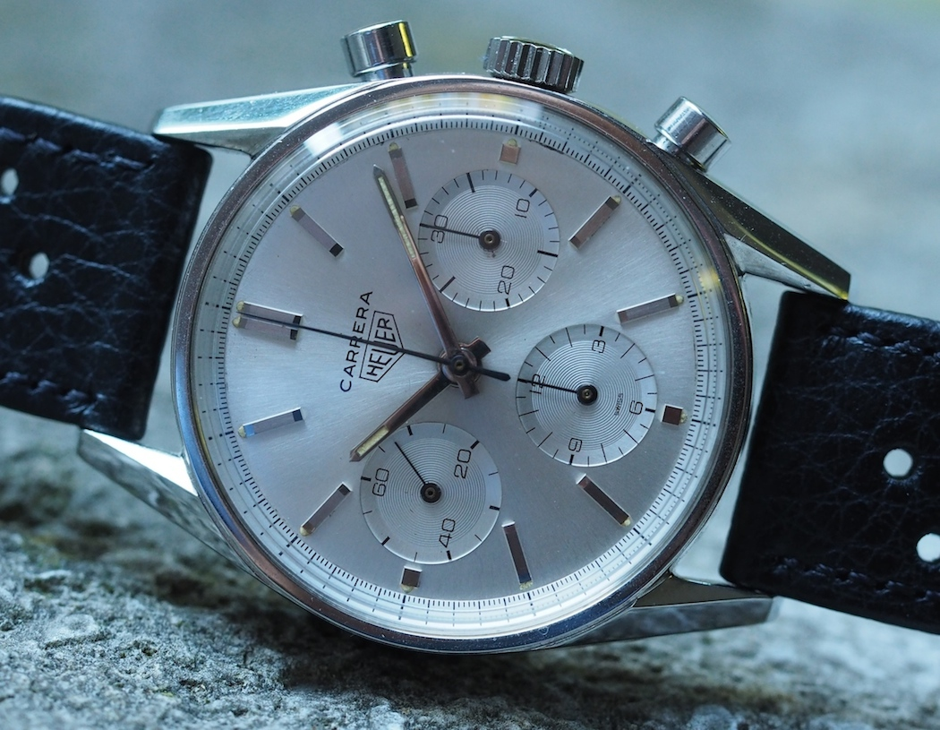 The essence of perfect, non-superfluous design is encompassed within the Heuer Carrera 2447.  This early design is my favorite.