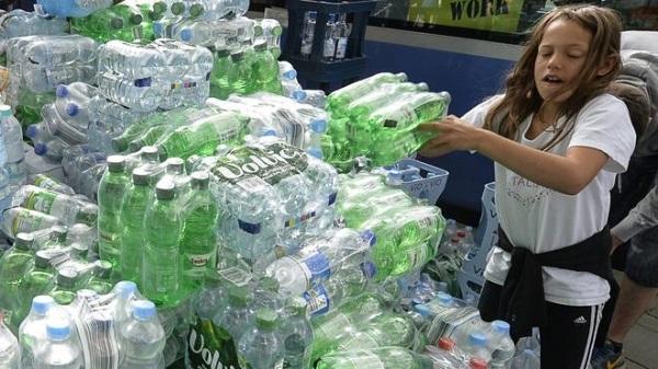 German girl getting water