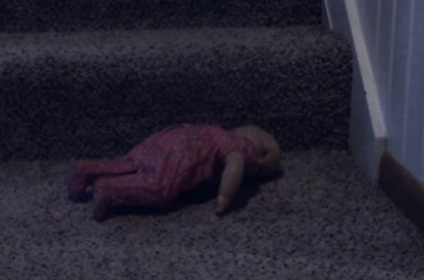 doll-on-stairs