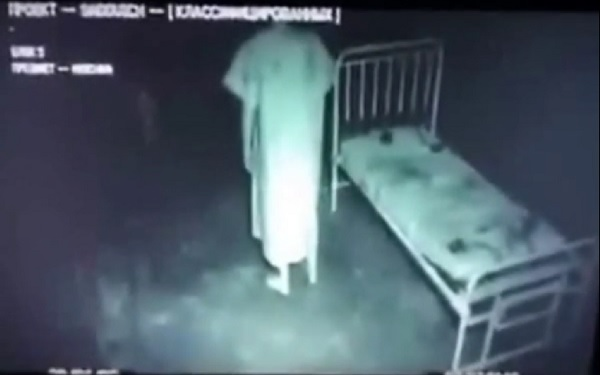 possessed-russian-man-on-bed-gets-up