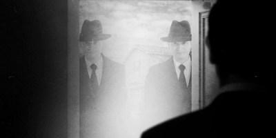 men in black at door