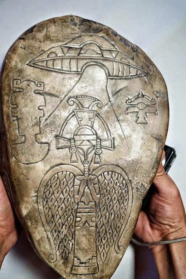 Aztec carving alien ship