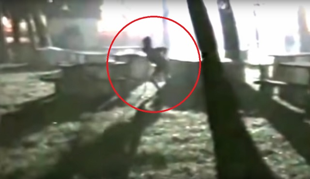 Alien in graveyard circled