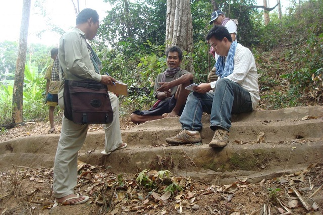 Archaeologists interviewing villager in Cambodia