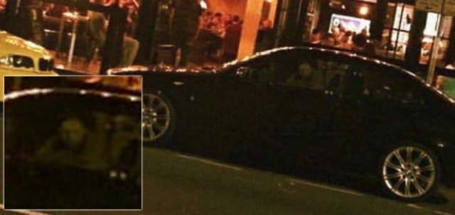 Ghost face peers back at car owner