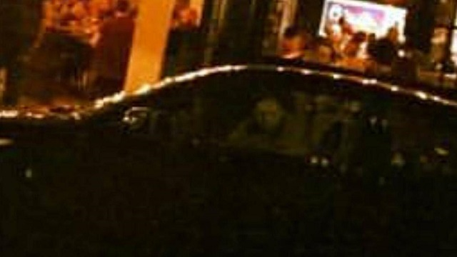 Ghostly face peers back at car owner