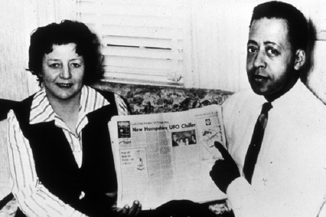 Betty and Barney Hill holding paper
