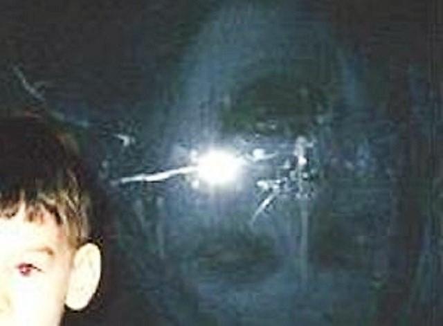 Boy standing next to phantom reflection closeup