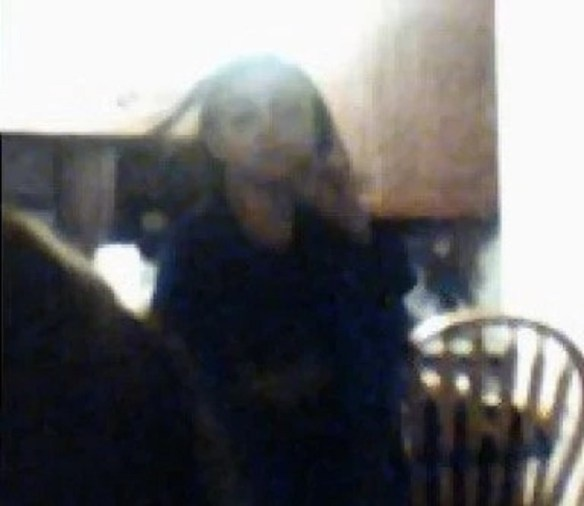 Restless ghost spirit in mother and daughter selfie photo