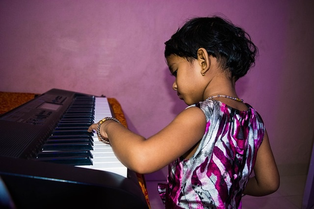 Cute girl playing piano talent
