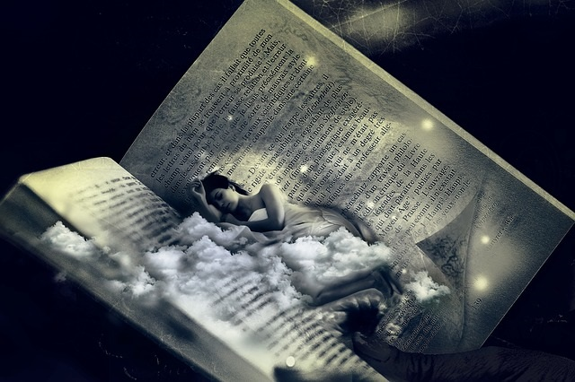 Dreaming woman in book