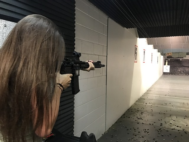 Girl at gun range shooting
