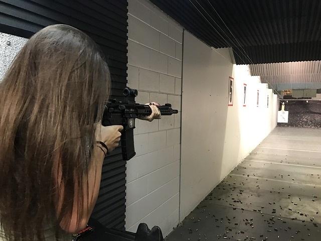 Girl at gun range shooting