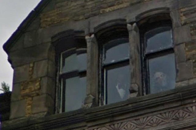Ghoul caught looking out window Stuart Hotel Liverpool