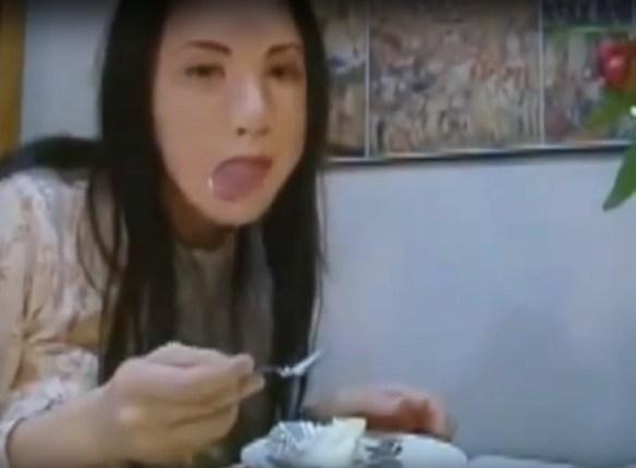 Creepy masked girl eating video