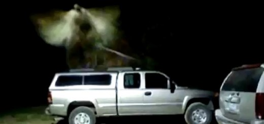 Security camera captures angel hovering over truck