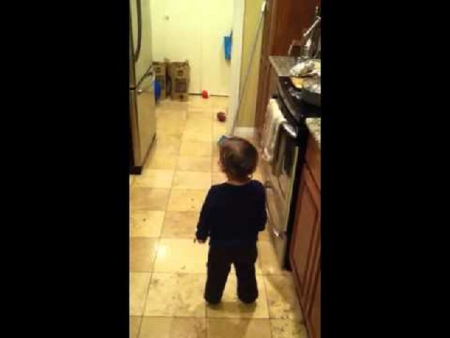 Toddler talks with spirit in kitchen