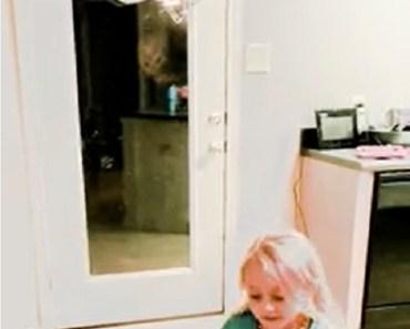 Aliens watch girl from door