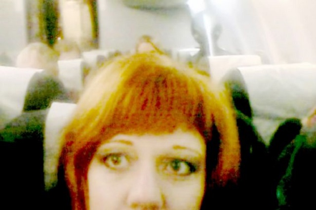 Olesya Podkorytov photobombed by Alien on plane