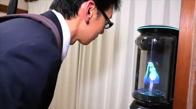 Akihiko Kondo greets his reality pop star wife Hatsune Miku