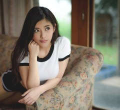 Asian Girl On Sofa
