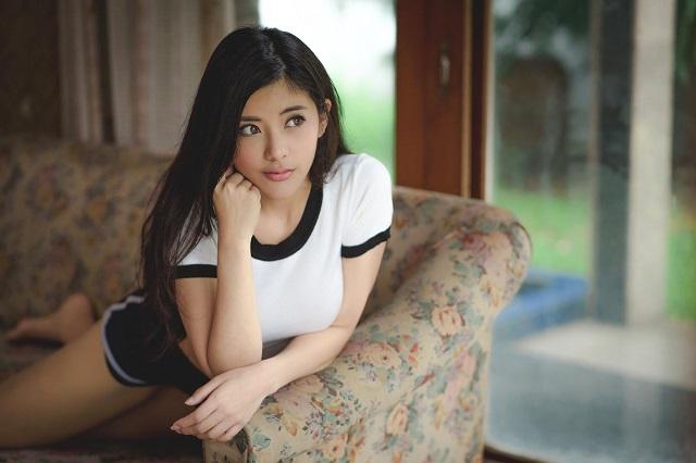 Asian Girl On Sofa