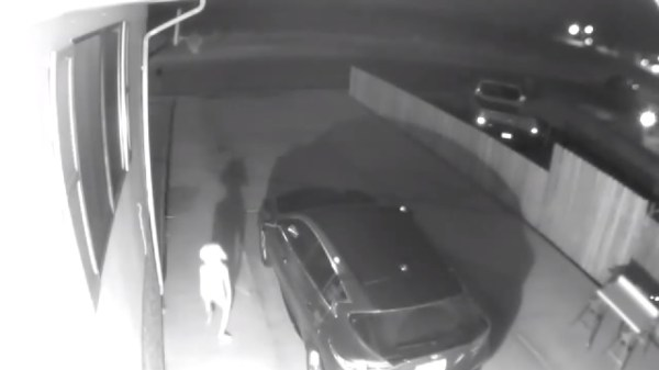 Home Security Camera Captures Elf Entity Walking On Driveway